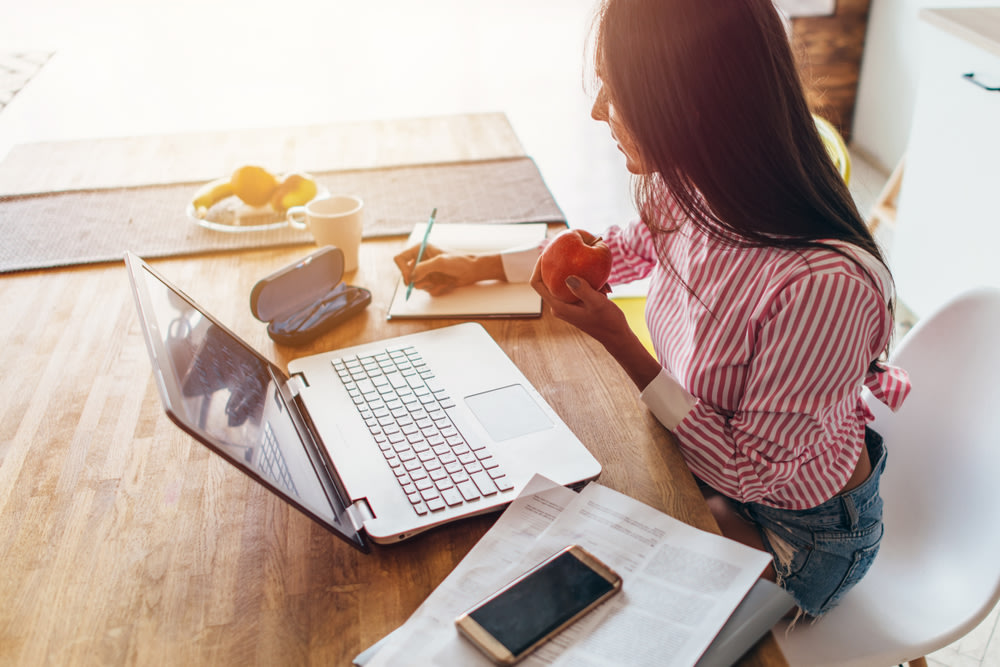 Young woman at home planning family budget and finances