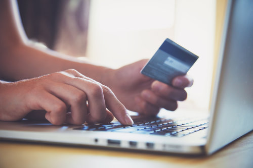 hands holding e-commerce card