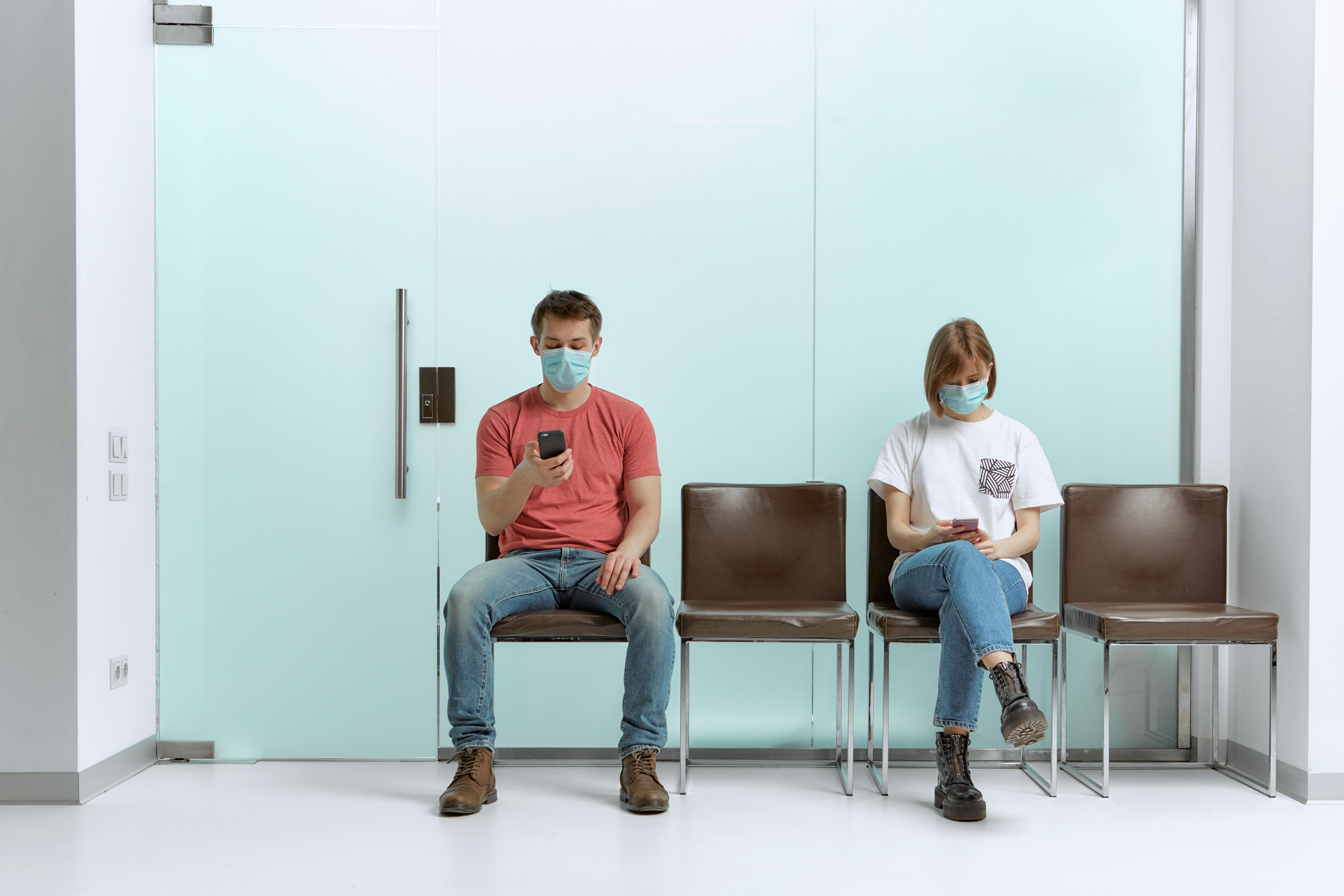 two people waiting to be seen by doctor during pandemic