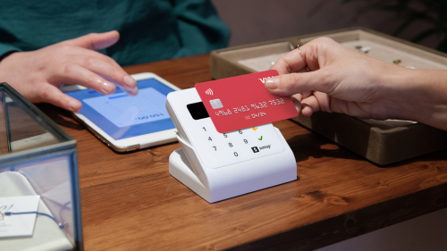 woman pays contactless in a store via a sumup air cardreader