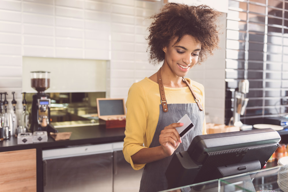 happy cashier taking a payment