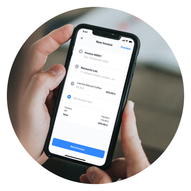 Person holding a mobile phone, using the SumUp app to create a new invoice with SumUp Invoices. The app allows you to easily create invoices for your business from mobile or web.