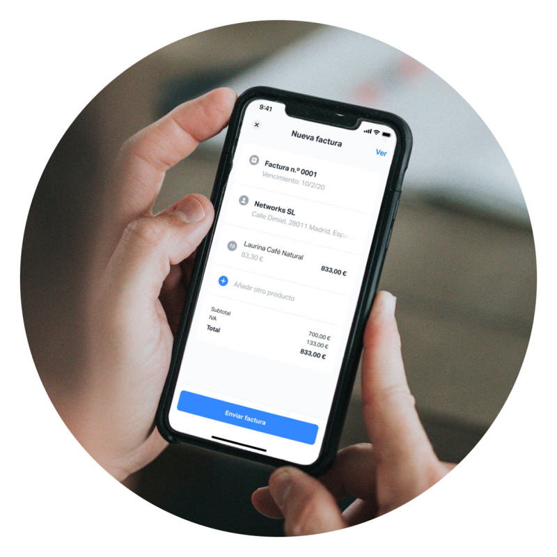Image of a person holding a mobile phone, using the SumUp app to create a new invoice with SumUp Invoices. The app allows you to easily create invoices for your business from mobile or web.