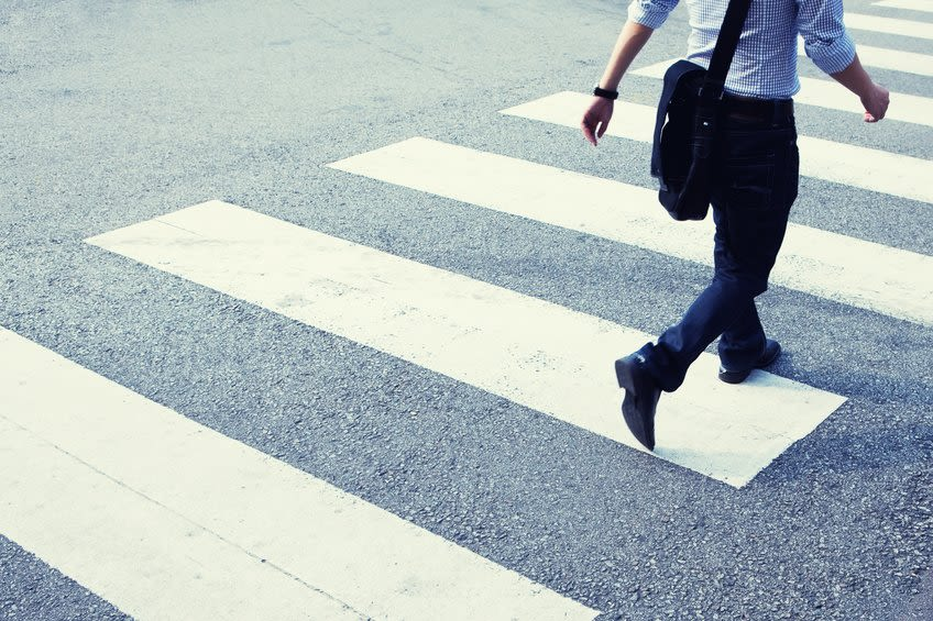 Shine Lawyers | Man rushing across zebra crossing | Shine Lawyers