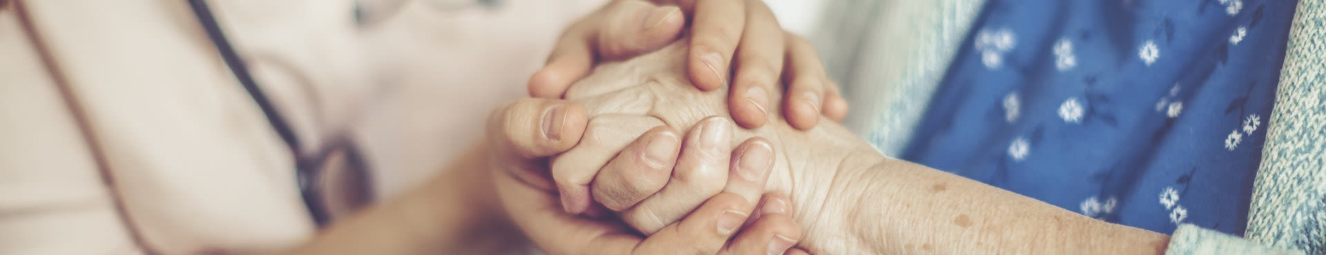 Shine Lawyers | Elder holding carers hands | Shine Lawyers