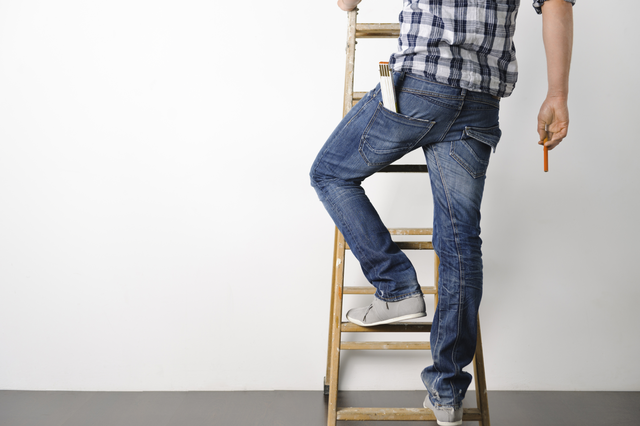Shine Lawyers | Man climbing up a ladder | Shine Lawyers
