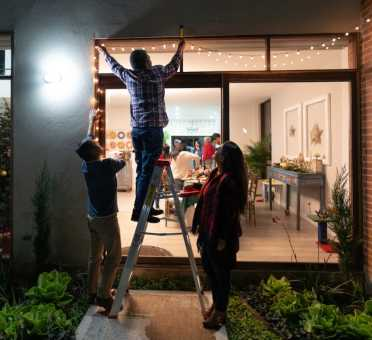Shine Lawyers | Putting up Christmas lights | Shine Lawyers