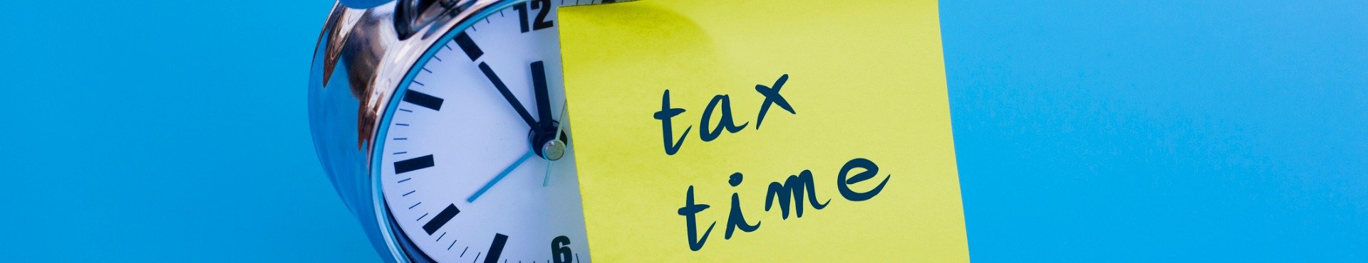 Shine Lawyers | Alarm clock with note tax time | Shine Lawyers