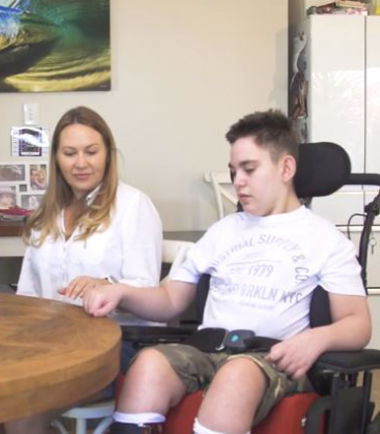 Shine Lawyers | Ethan Allen and his mum sitting at their kitchen table at home