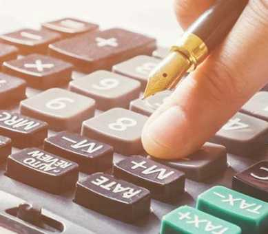 Shine Lawyers | Man's hand calculating finance | Shine Lawyers