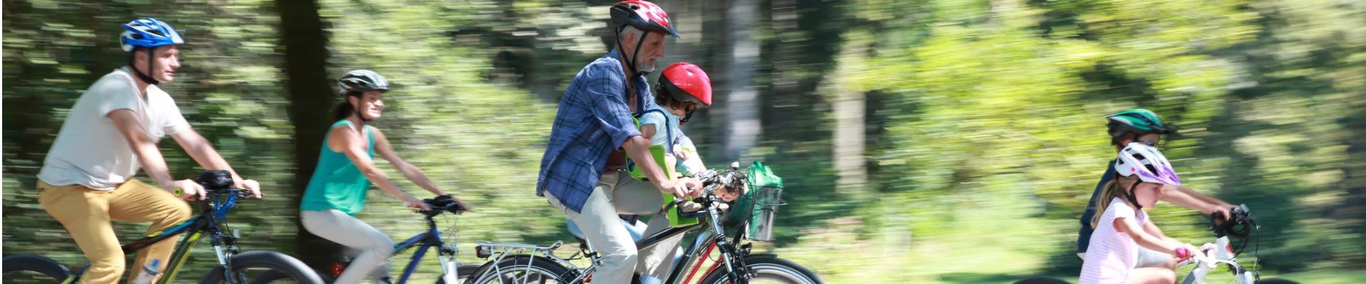 Shine Lawyers | Family cycling and wearing helmets