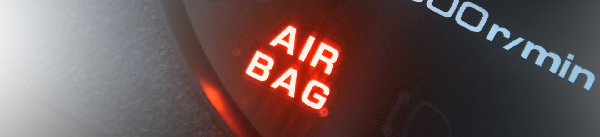 Shine Lawyers | Red lighting airbag control symbol in car