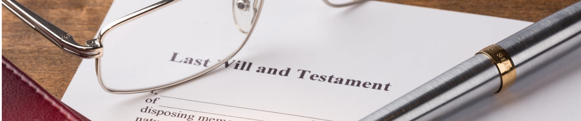 Shine Lawyers | A last will and testament with a pair of glasses