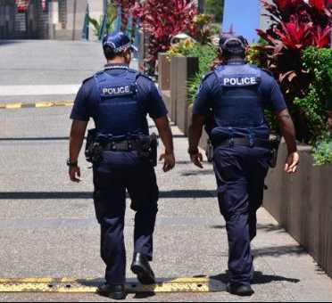 Shine Lawyers | Two police officers walking together | Shine Lawyers