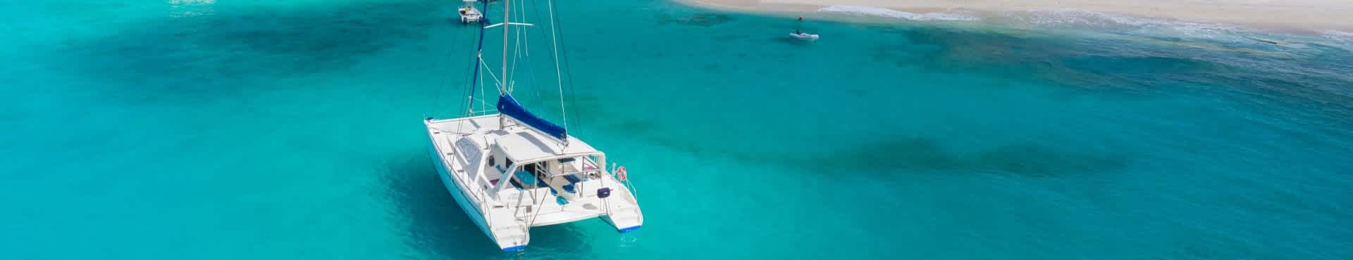 Shine Lawyers | Catamaran sailing around island | Shine Lawyers
