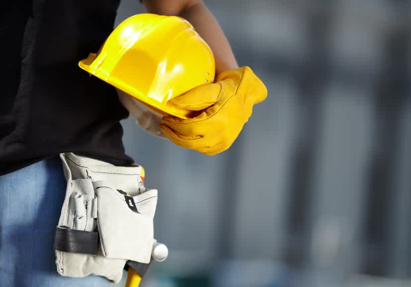 Shine Lawyers | Laborer holding a hard hat on a construction site | Shine Lawyers