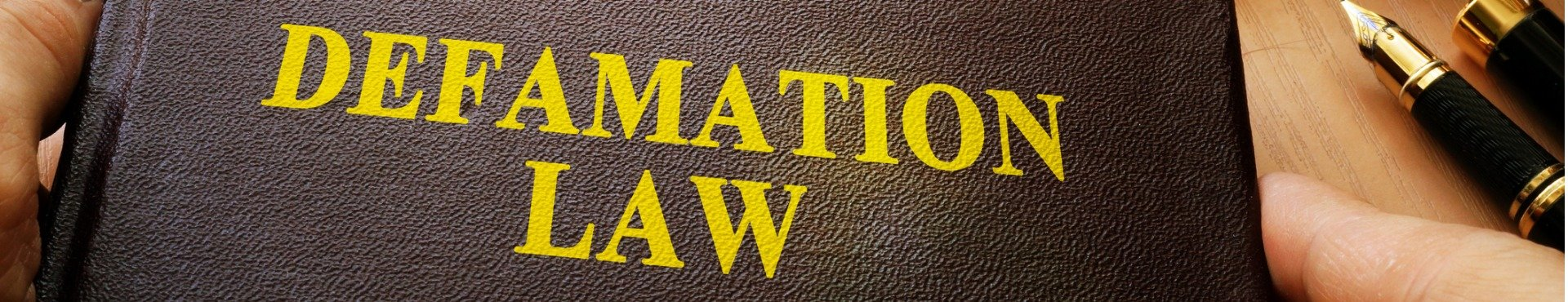 Shine Lawyers | Defamation law and gavel on a table