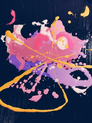 Ink splatters in pink yellow and purple