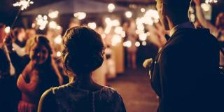 man-and-woman-walking-with-sparkler-bokeh-in-the-backgroud