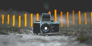 old-slr-camera-with-out-of-focus-background