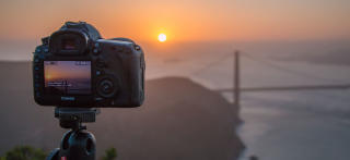 camera-in-sunset-at-golden-gate-bridge