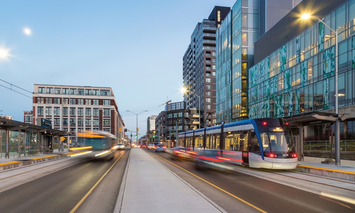 View of traffic down King Street in Kitchener featuring the ION train