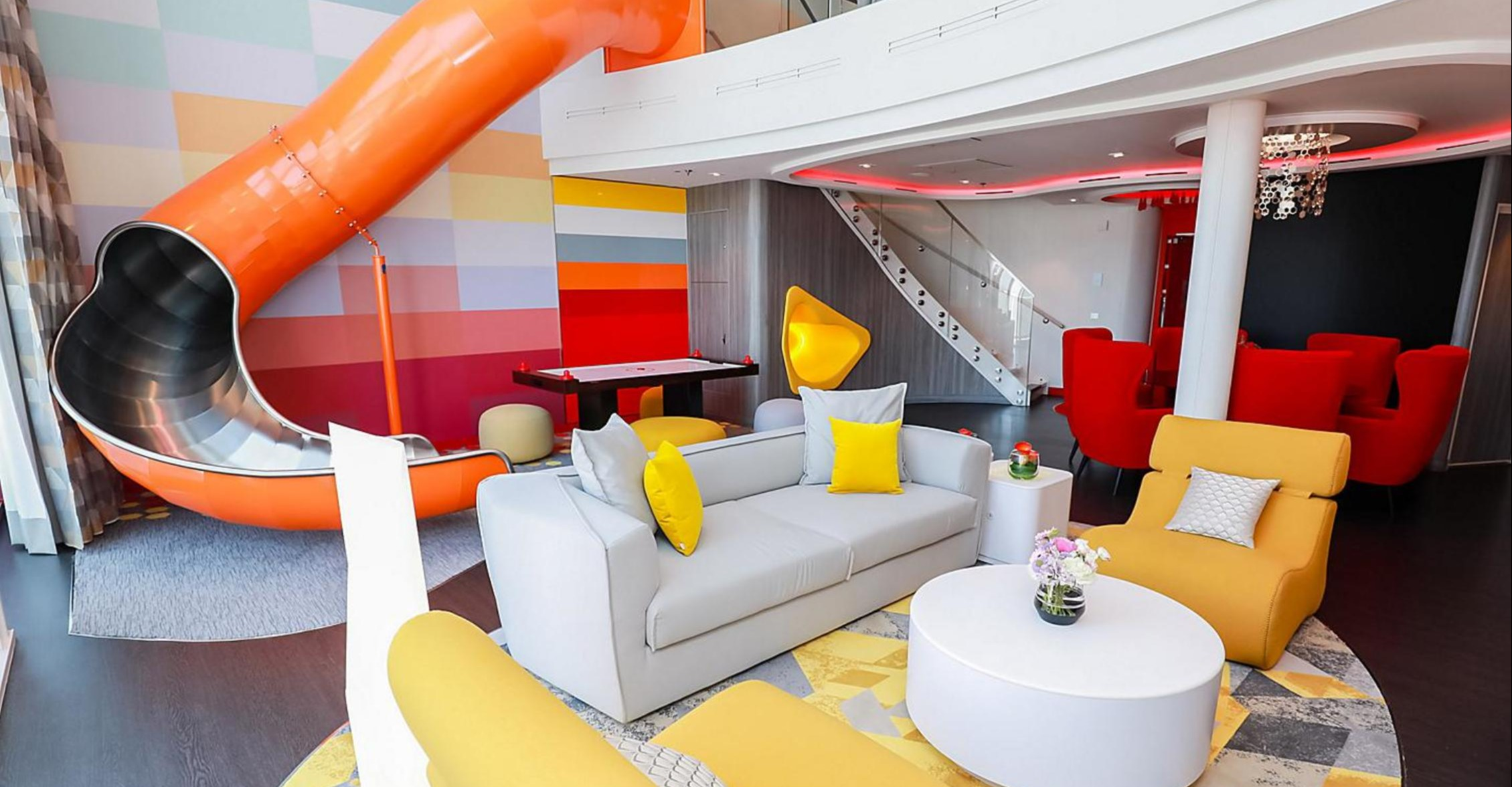 spectrum-of-the-seas-ultimate-family-suite-living-room-slide