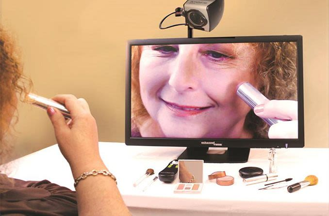 person using magnifying camera low vision aid