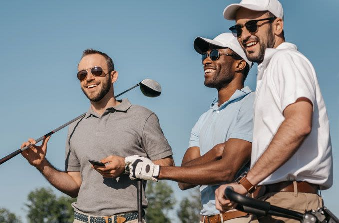 Three male golfers wearing sunglasses.