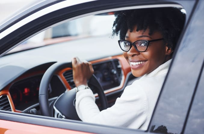 woman driving while wearing glasses