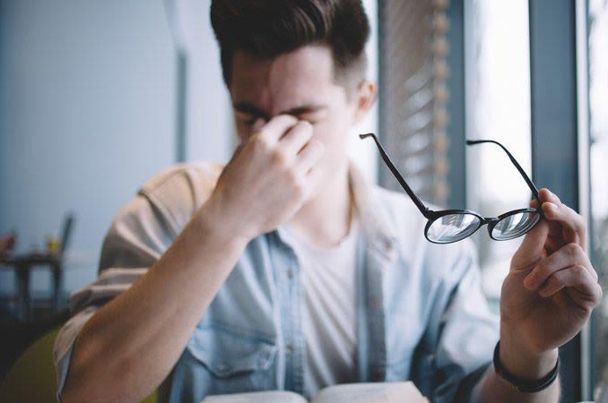 man experiencing eye strain