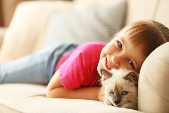 Girl on couch with a cat