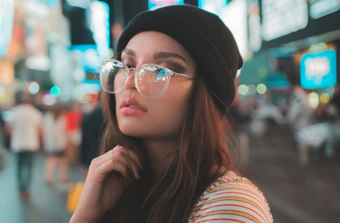 Woman with eyeglass frames resting on nose