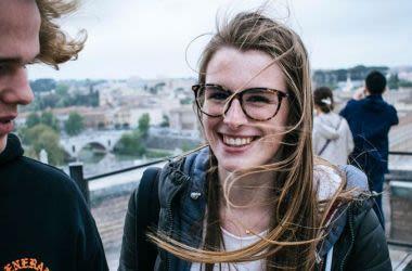 Woman on windy terrace wearing glasses