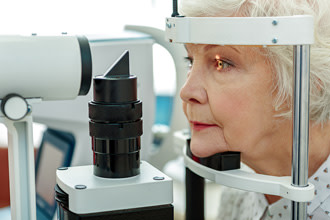 elderly woman receiving eye exam