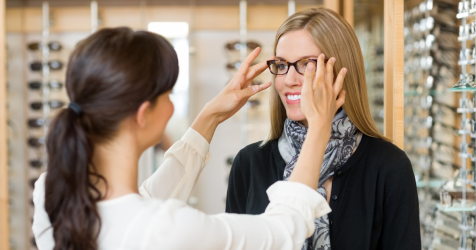 woman being fitted with spectacles
