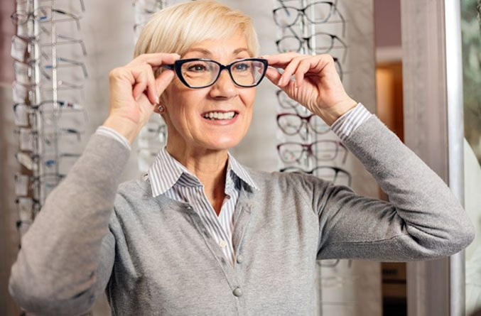 Mature woman trying on eyeglasses