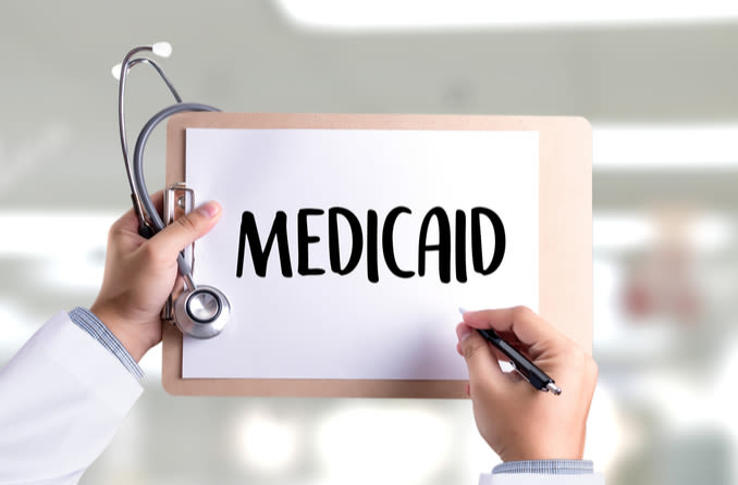 Medicaid written on a clipboard