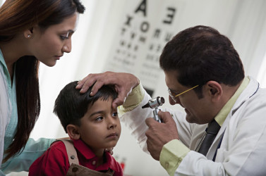 Young Indian boy getting an eye exam - India