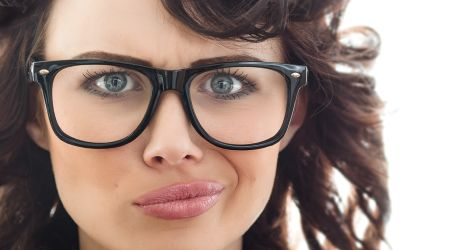 Unhappy woman with spectacles