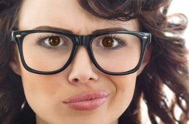 Unhappy woman with eyeglasses