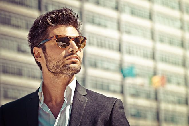 Man wearing tortoise shell frame sunglasses outdoors