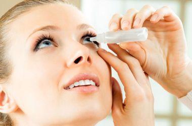 Woman using eye drops properly.