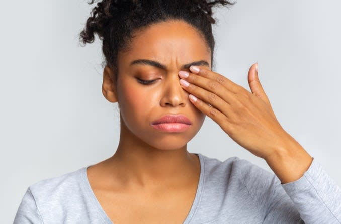 Woman with eyes closed from eye discomfort