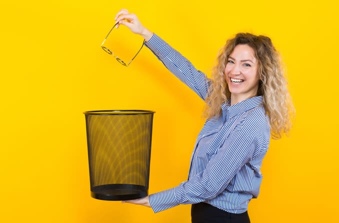 woman throwing her glasses away