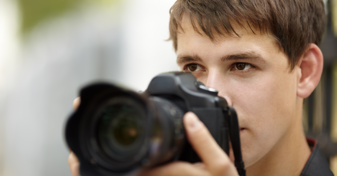teen holding a camera
