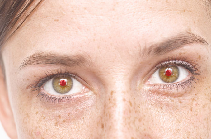 Close-up of woman with red eyes in a photo