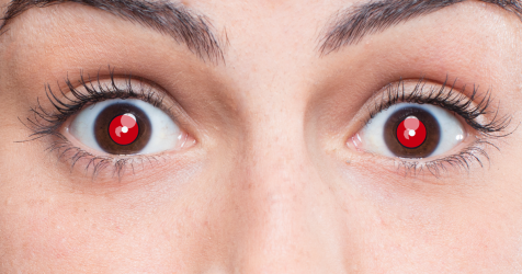 Close-up of person with red eyes in a photo