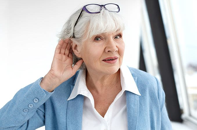 Mature woman having a hard time hearing