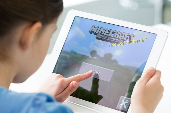 child playing game on tablet computer
